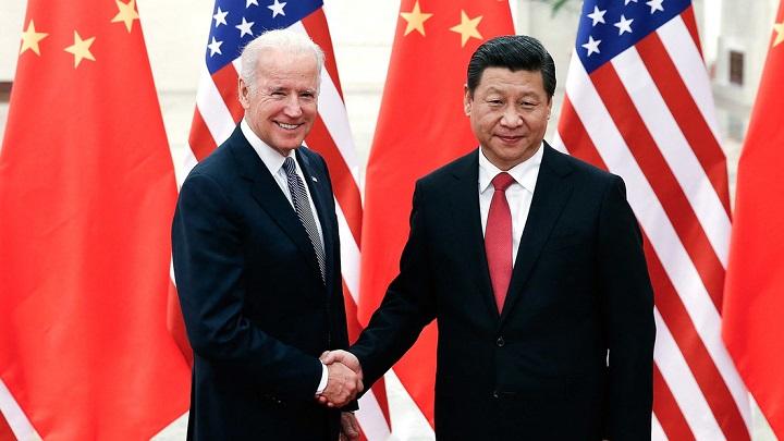 Xi Jinping y Joe Biden durante un encuentro en Pekín, 4 de diciembre de 2013. Lintao Zhang AFP
